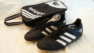 Adidas size 8 1/2 with cleats. Great shape