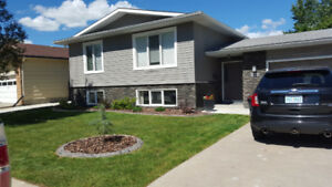 Bright 3 bedroom east side with garage and beautiful backyard.