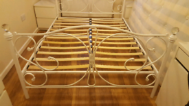 White metal double bed with glass finials