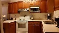 SOLID OAK KITCHEN CABINETS - USED