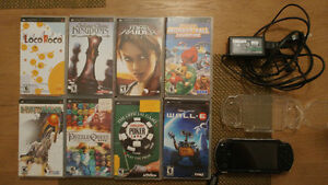 PSP-1001 with charger, 8 great games and a clear case