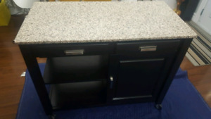 Kitchen island with granite countertop. Shelves & 2 Drawers