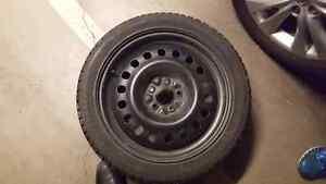"4 225x45x18"" winter tires on wheels"