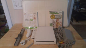 Nintendo Wii System With Remote, Nunchuk And Wii Fit And 2 Games