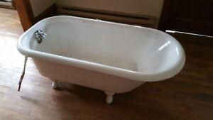 Claw foot cast iron bath tub around 1935 vintage.
