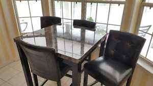 Beautiful counter height black table and 4 chairs.