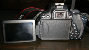 DSLR Canon T5i with 18-135 mm and 50 mm lens
