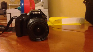 Canon T3 Body with kit lens and accesories.