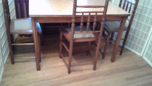 """Dark Oak finished Table and Five Solid Oak Chairs Size: 50"""" by 3"""