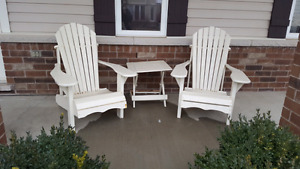 Muskoka chairs with table - not folding and made from wood.