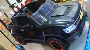 Kids ride on ford truck with 4 motors 12v door open $440