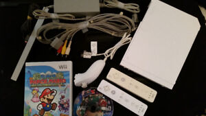 WII CONSOLE WITH 2 GAME DISCS AND 1 INSTALLED GAME