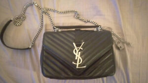 Yves Saint Laurent - Never been used purse.