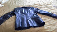 Black Leather Jacket Size Smalll In excelent  condition.