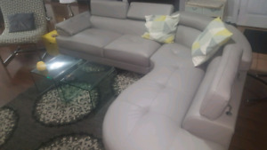 Super modern light gray sectional. Bonded leather.10 months old