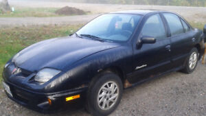 2002 Pontiac Sunfire - Comes with Winter Tires on Rims