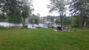 Votre roulotte au bord du lac Magog avec quai