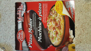 Betty Crocker pizza maker. NEVER USED. Makes more than pizzas.