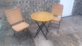 Wicker garden table and two chairs folds for easy storage. £50.00. Lin