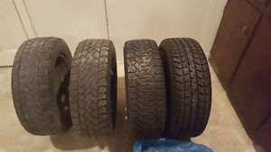 2 used and 2 new winter tires