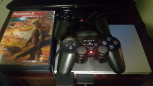 PlayStation 2 Slim with 2 Controllers and 3 Games