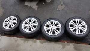4 Nissan tires with rims