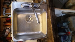 Single sink with faucet