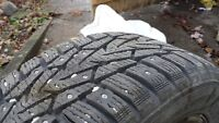 4 Studded Snow Tires on Black Steel Rims with Sensors