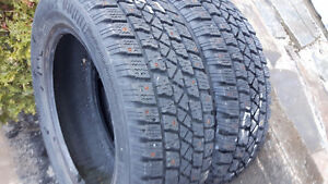 pair of 195/60r15 studed winter tires for sale, new never used.