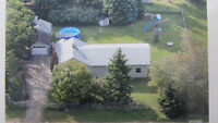 Acreage Living! Close to Prince Albert and the Lakes
