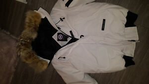 Women's white canada goose jacket in a medium