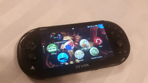 PS Vita with 12 games and accessories.