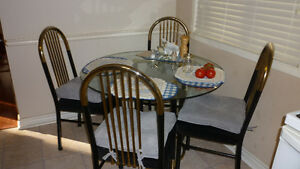 Glass top kitchen table and 4 padded chairs. Cambridge Kitchener Area image 1