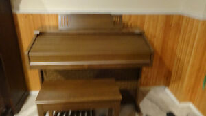 Electric organ, bench and music