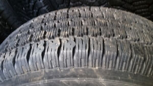215/70/R15 Tires on Rims. Good Condition for Caravan.