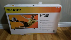 "Unopened SHARP 32"" 720p HD TV"
