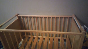 Wooden crib. Apartment size