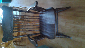 Antique pressed back solid wood Hibner rocking chair