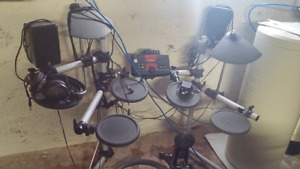 Yamaha DTX electronic drum kit with speakers and amp