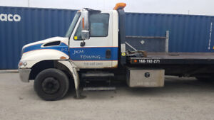4 International flat beds Tow Trucks