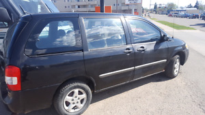 2000 mazda mpv. Comes with safety!