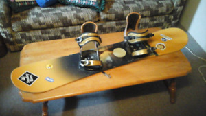 Burton Snow  Board With Bindings.    PUNCH. model
