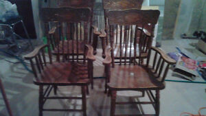 Two solid oak pressed-back Chairs for $10 each London Ontario image 1