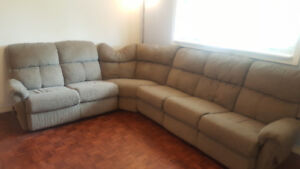 Sectional couch, coffee table and dining table for quick sale