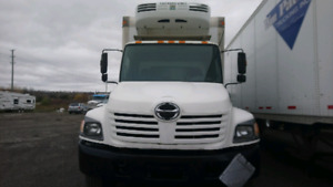 2005 Hino 268 with tailgate and reefer.