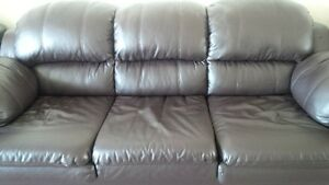 dark brown bonded leather sofa and love seat