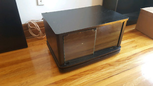 Swiveling black TV stand / media center with glass cabinet