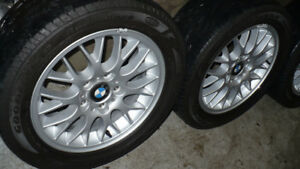 """BMW 16"""" OEM rims with 225 50 16 Goodyear all season tires."""