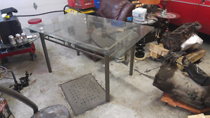 Glass top dining room table.  Metal frame