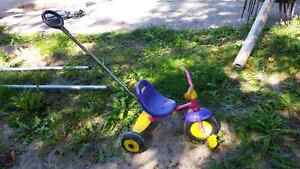 Kettler trike with push handle